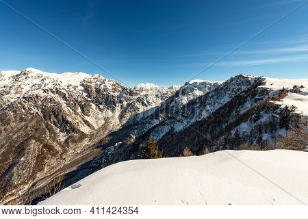 Mountain Range Of The Monte Carega In Winter With Snow, Called The Small Dolomites (piccole Dolomiti