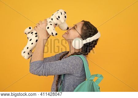 Cute Smiling Schoolgirl Carry Soft Toy Dog. Girl Little Schoolgirl. Modern Schoolgirl Daily Life. Pr