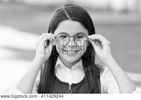 An Intellectual Look. Happy Child Look Through Glasses Outdoors. Vision Screening At School. Eye Tes