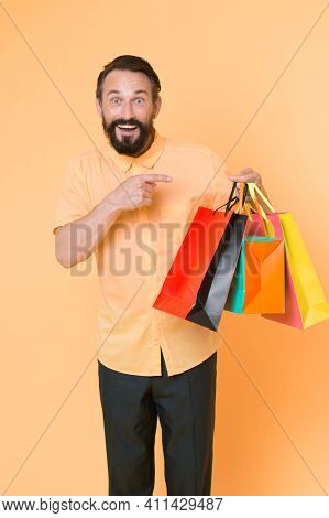 Best Outfit Ever. Brutal Caucasian Hipster With Moustache. Bearded Man With Shopping Bags. Happy Hol