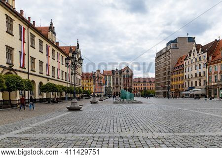 Wroclaw, Poland - May 03 2020: Wroclaw Market Square Full Of Old Colorful Tenement Houses At Cloudy