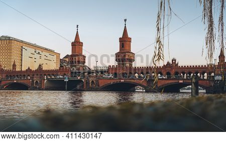 Berlin, Germany - March 03 2021: View Towards Oberbaum Bridge During Sunset. It Is A Double-deck Bri