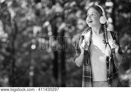 English As Second Language. Happy Child Listen To Headphones Natural Outdoors. Language Learning Cou