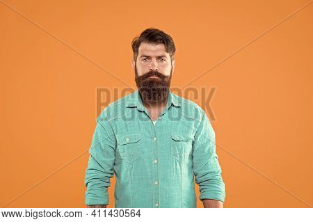 In His Own Style. Serious Man Orange Background. Bearded Man In Casual Denim Style. Menswear Store.