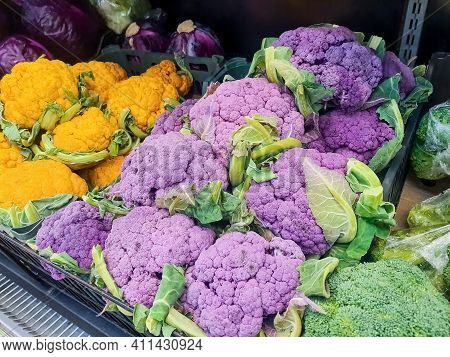 Bunches Of Fresh Yellow, Purple And Green Cauliflower Heads At The Farmers Market.assorted Colorful