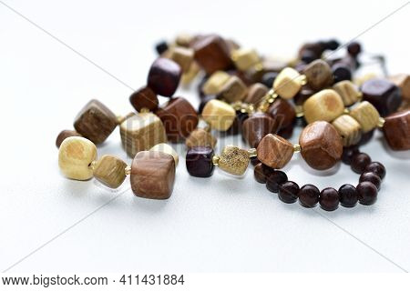Beautiful Wooden Beads On A White Background