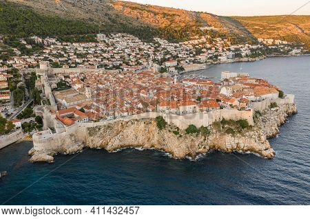 Aerial Drone Shot Of Dubrovnik Old City By Adriatic Sea In Summer Sunset Golden Light In Croatia Coa