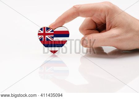 Flag Of The State Of Hawaii. Love And Respect Hawaii. A Man's Hand Holds A Heart In The Shape Of The