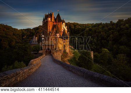 Eltz Castle And Stone Bridge In Sunset Light, Germany