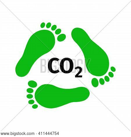Reducing Carbon Footprint Concept. Green Footprints In Form Of Recycling Symbol And C02 Sign. Enviro