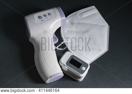 Pulse Oximeter, Digital Fever Thermometer And Ffp2 Protective Face Mask, Covid19 Pandemic Disease, M