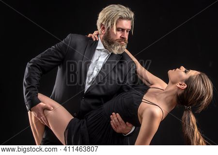 Salsa Dancing Couple. Young Luxury Pair Dance Isolated On Black Background. Romantic