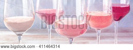 Pink Wine Of Various Shades. Toned Panorama, Many Wineglasses