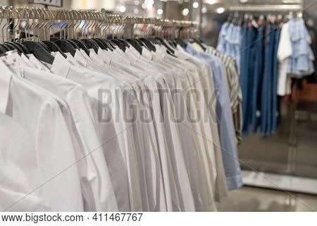 Close-up of clothes on hangers in shop for sale