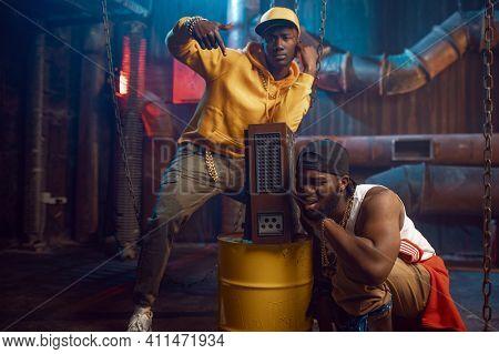Young rappers, break-dance performing in studio