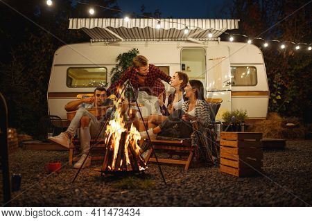 Friends cooking on campfire, picnic at camping