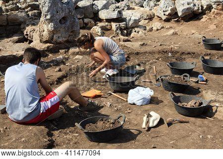 Torre D\'en Galmés, Menorca / Spain - June 23, 2016: Archaeologist In Prehistoric Area At Torre D\'e