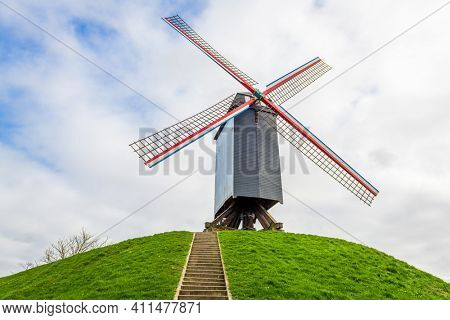 Bruges, Belgium old windmill in the park.