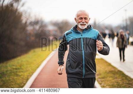Active Senior Man Is Jogging. Healthy Retirement Lifestyle.