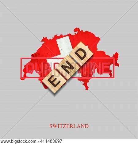 End Of Quarantine. The Inscription On Wooden Blocks On The Background Of The Map Of Switzerland. The
