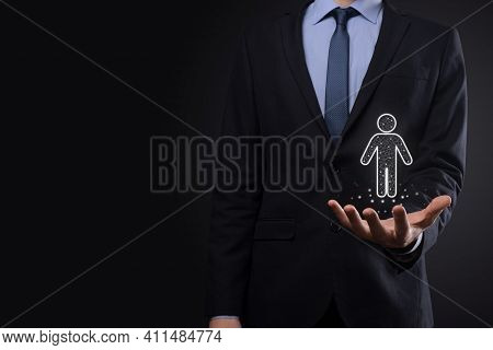 Businessman Holds Man Person Icon On Dark Tone Background.hr Human ,people Icontechnology Process Sy