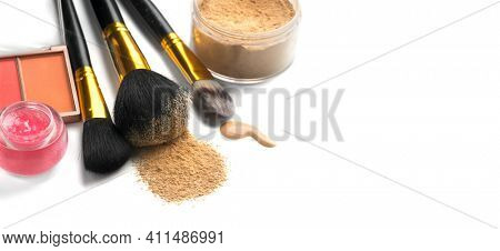 Make-up cosmetics. Face contouring make up, contour. Highlight, shade. Makeup Products, make up artist tools. Foundation, concealer. Brushes, blush, lip gloss, powder isolated on white background