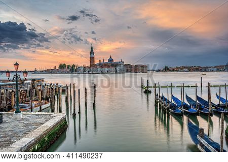 Dramatic Sunrise In Venice, Italy, With Some Of The Traditional Gondolas