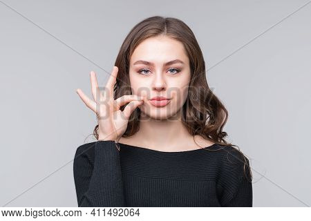 Keep The Secret - Keep Quiet. Young Woman Zips Her Mouth Shut, Promises To Keep Secret. Silence And