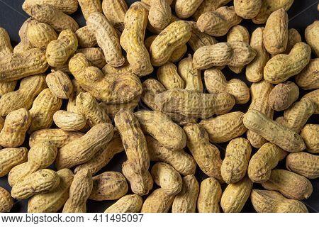 Peanuts On A Black Background. Full Screen Peanuts. Peanuts In Shell