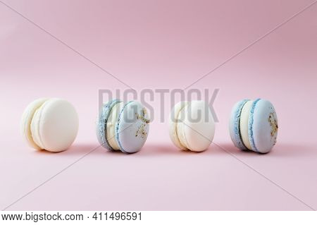 White And Blue Macaroons On The Table, Macaroons On Pink Background
