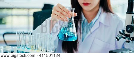 Focused Young And Beautiful Female Asian Scientist Wearing Labcoat And Safety Eyewear Doing Medical