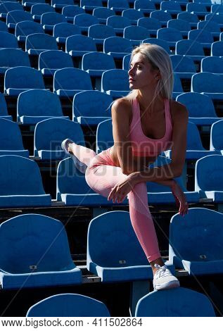 Athletic Woman In Fitness Wear Stretching On Stadium, Stretch