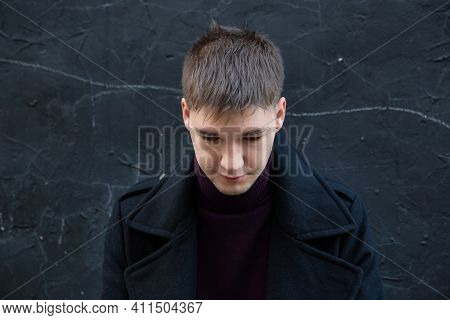 European Young White Man Isolated On Black With Short Dark Hair