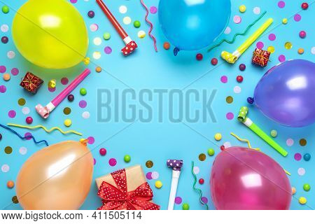 Colorful Party Frame With Red Gift Box With Various Party Confetti, Balloons, Streamers, Pokers And