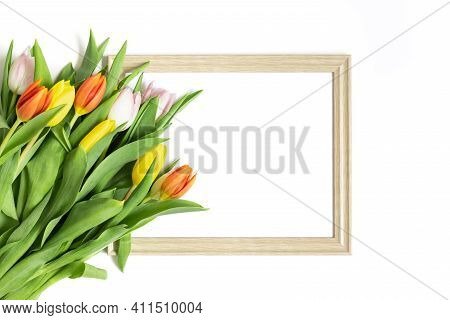Frame With A Bouquet Of Tulips Flowers Isolated On A White Background. Floral Frame. Spring Concept,