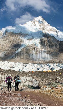 Mount Nuptse, Mount Everest Base Camp And Two Toutists, Khumbu Glacier, Sagarmatha National Park, Ne