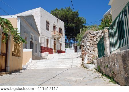 Looking up the Kali Strata steps at Yialos on the Greek island of Symi. The 400 steps lead up to the village of Chorio.