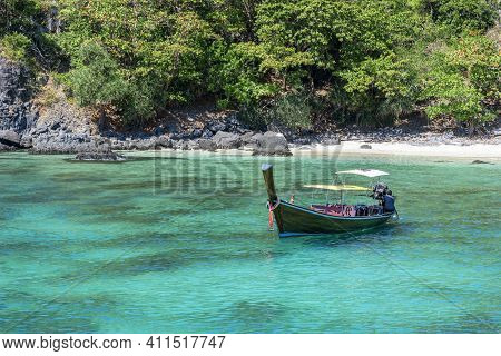 Boat In The Turquoise Sea Off Racha Island In Thailand