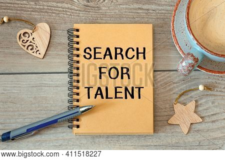 Search For Talent - Inscription On A Notebook And Cup With Coffee On A Wooden Table