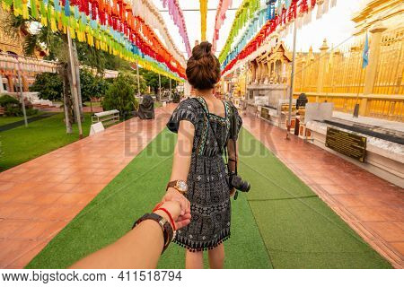 Back View Of Tourist Woman Holding Her Boyfriend Hand And Visiting Wat Phra That Hariphunchai An Ico