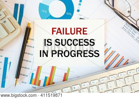 Failure Is Success In Progress Is Written In A Document On The Office Desk With Office Accessories,
