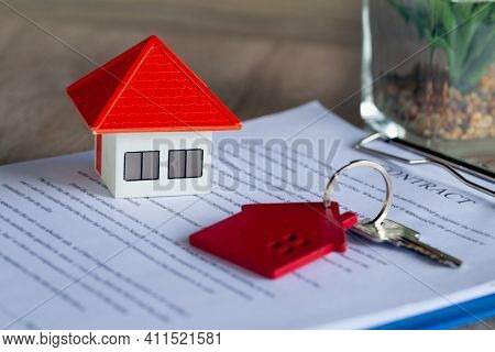 Orange House And A Bunch Of Red House Keys On The Contract Contract Concept, Signature In Document,