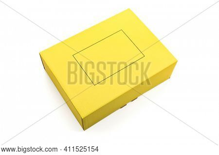 Yellow corrugated cardboard parcel isolated on white background