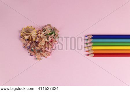 Sharpened Colored Pencils And Heart-shaped Pencil Shavings. Rainbow Or Lgbt Pencils. Decoration For