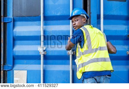 Smart African American Engineer Man Wearing Industrial Work Wear Coverall And Protective Helmet Doin