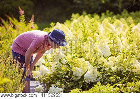 Handsome Teenage Boy Choose Flower For Mothers Day