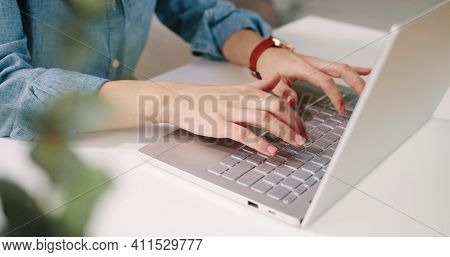 Close Up Shot Of Caucasian Female Hands Working On White Modern Computer Typing And Tapping On Keybo