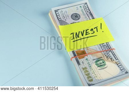 Wad Of Dollars Money Cash In Elastic Band Copy Space Background,yellow Note Text Written Invest,conc