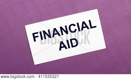 On A Lilac Background, A White Card With The Words Financial Aid
