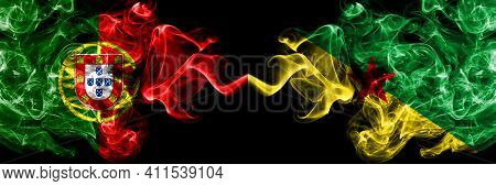 Portugal, Portuguese Vs France, French Guiana Smoky Mystic Flags Placed Side By Side. Thick Colored
